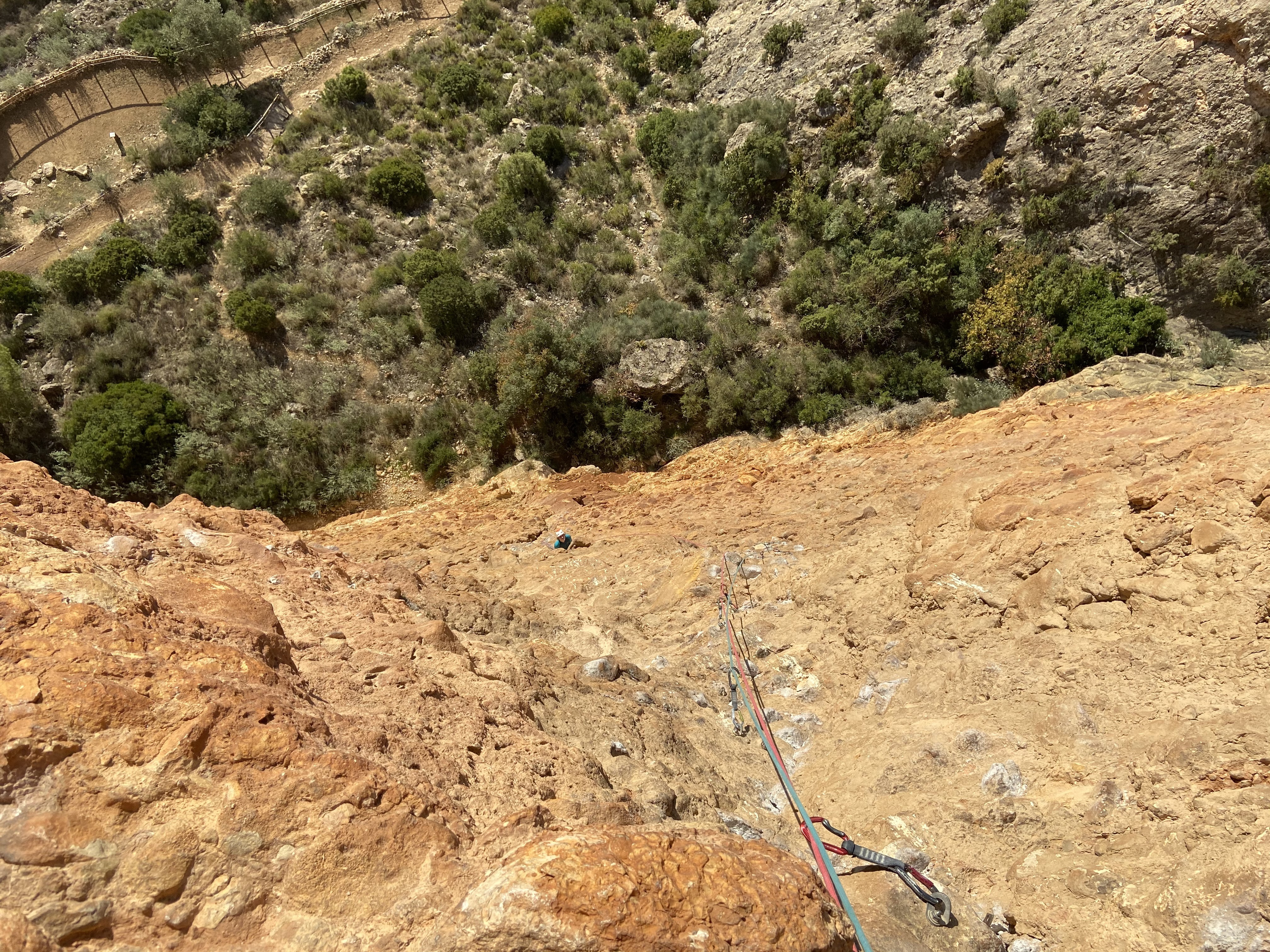 """View looking down from the multi pitch route. There are lots of chalked """"potatos"""" conglomerate rocks"""