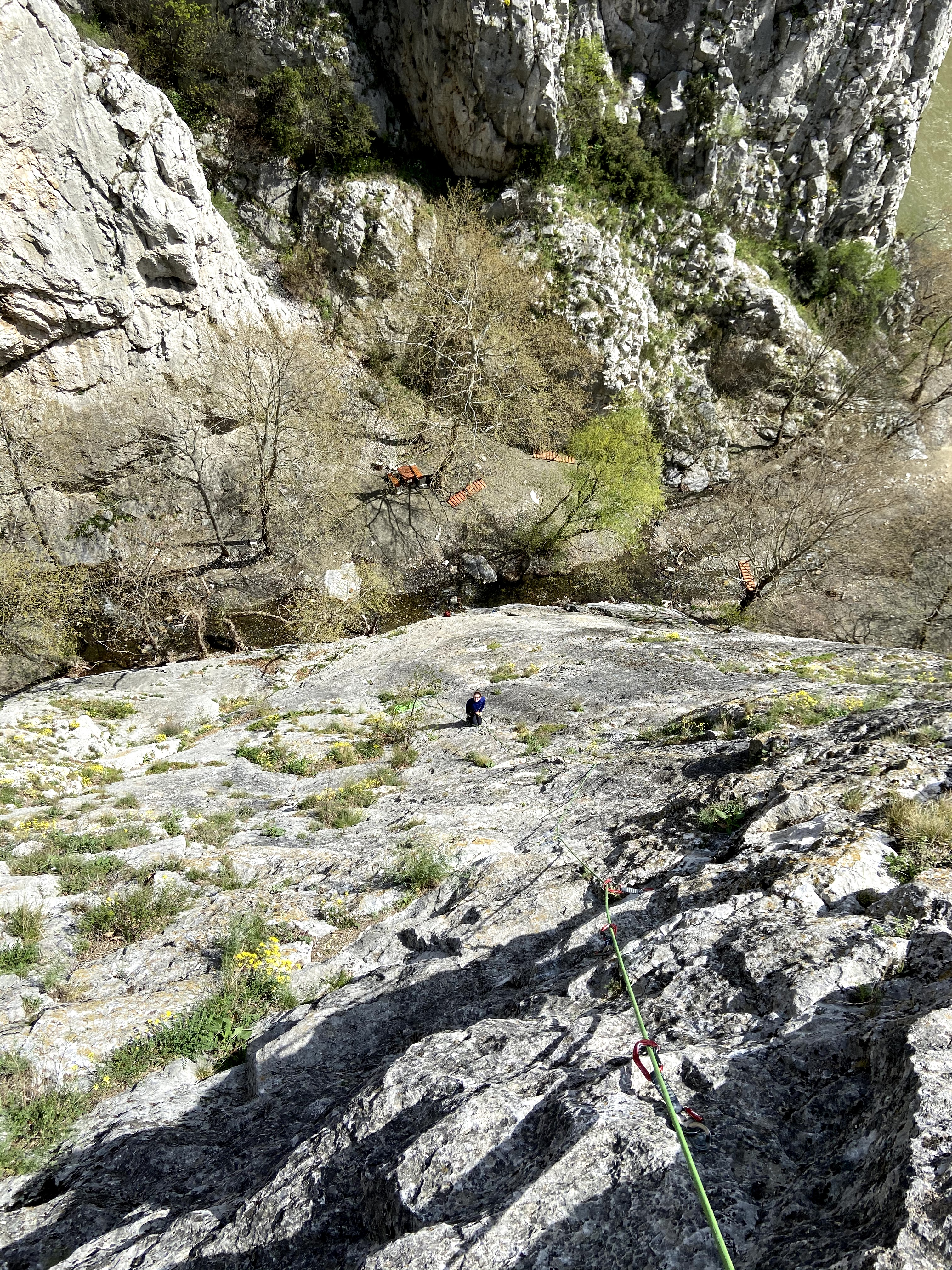 Looking down at climber on the belay of a multipitch at sector all inclusive.