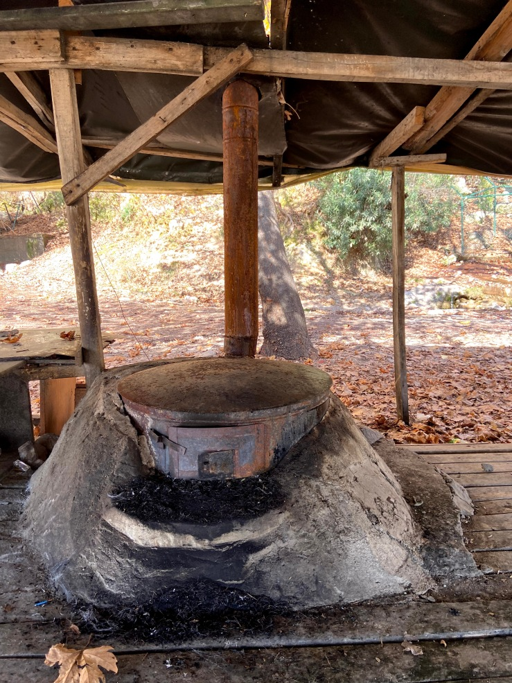Oven with a large surface area on top to cook the bread and dough. On the front there is a hatch which they put the wood and start a fire underneath