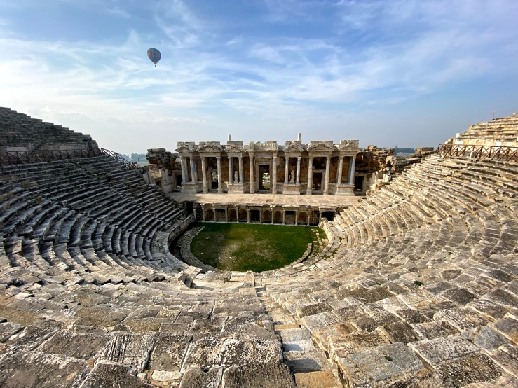 Roman amphitheatr, there is worn stone with huge columns with elaborate statues. This is the ancient city at Pamukkale