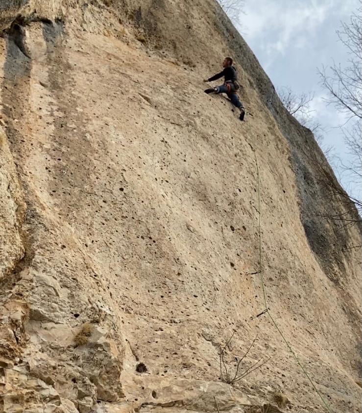 Climber on pocket rock at Pecka, Bosnia and Herzegovina.