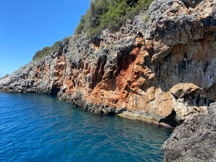 Small sea crag with deep blue sea at the bottom.